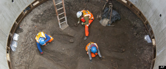 In this undated but recent photo supplied Friday March 15, 2015, by the London Crossrail Project, showing archaeologists working on the UK's largest infrastructure project, Crossrail, as they uncover an historical burial ground at Charterhouse Square, Farringdon in central London. (AP Photo / Crossrail Project)
