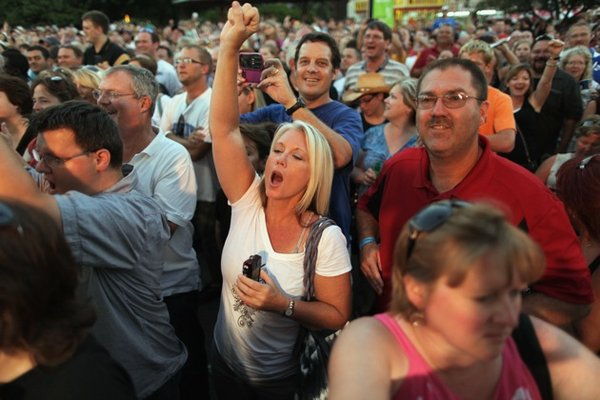 Fairgoers cheer for Sarah Palin while she appears on the Sean Hannity Show at the Iowa State Fair, August 12, 2011